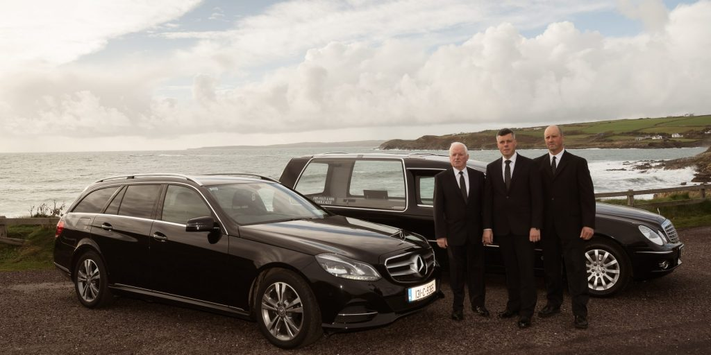 cars-and-staff-at-dunworley-scaled.jpg